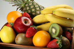 Fruit bowl with fresh fruits. A wood made fruit bowl with fresh fruits Royalty Free Stock Images
