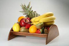 Fruit bowl with fresh fruits. A wood made fruit bowl with fresh fruits Royalty Free Stock Photos