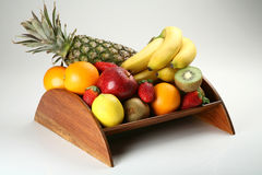 Fruit bowl with fresh fruits. A wood made fruit bowl with fresh fruits Stock Image