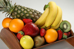 Fruit bowl with fresh fruits. A wood made fruit bowl with fresh fruits Stock Photos