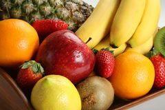 Fruit bowl with fresh fruits. A wood made fruit bowl with fresh fruits Royalty Free Stock Photography