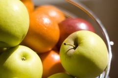 Fruit bowl full of fresh apples and oranges Stock Photos