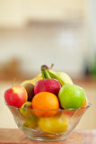 Fruit bowl in kitchen. Fresh fruit in a bowl standing in a kitchen Royalty Free Stock Photo