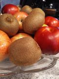 Fruit in bowl. Nectarines, apples and kiwi fruit in a bowl Royalty Free Stock Images