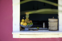 Fruit bowl in the old house window. PORTO SEGURO, BA, BRAZIL - MARCH 7, 2015 - Fruit bowl in the old house window, in the small village of Trancoso, in Southern Royalty Free Stock Image