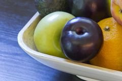 Fruit Bowl Plum Avocado Royalty Free Stock Photography