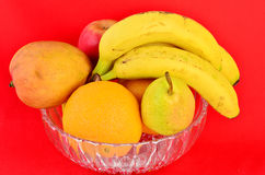 Fruit Bowl on Red Background Royalty Free Stock Photos