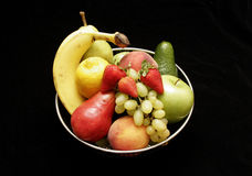 Fruit bowl on satin Royalty Free Stock Photography