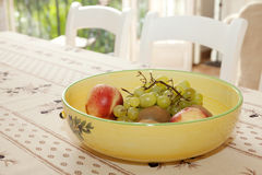 Fruit bowl on a table stock images