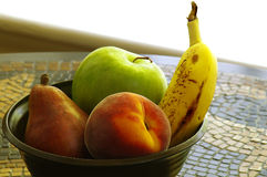 Fruit bowl on tile table Stock Image