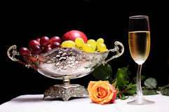 Fruit bowl. With wine glass and grapes Stock Images