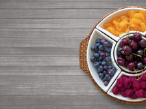 Fruit bowl on wooden background Stock Photos