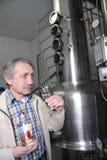 Fruit brandy maker Royalty Free Stock Image