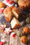 Fruit bread panettone and christmas decoration close-up. vertica Stock Images