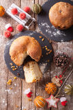 Fruit bread panettone and christmas decoration close-up. Vertica Royalty Free Stock Image