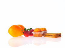 Fruit, bread and pastries. Royalty Free Stock Photography