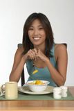 Fruit at breakfast. Asian woman eating fruit at breakfast Stock Photos