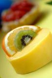 Fruit cake. Delicious cake with orange kiwi strawberry fruit stock photos