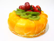 Fruit Cake. Delicious cake with mango kiwi strawberry grape Royalty Free Stock Images