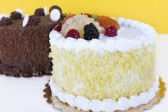 Fruit cake. Delicious fruit cake with chocolate cake in the background stock images