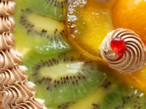 Fruit cake. Cake fragment with cream and fruits in jelly Stock Images