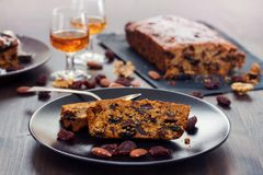 Fruit cake on black plate on brown wooden background Royalty Free Stock Photos