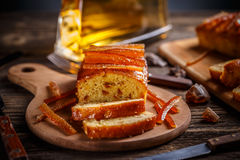 Fruit cake with candied orange zest. On wooden cutting board Royalty Free Stock Photo