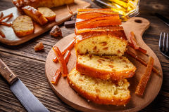 Fruit cake with candied orange zest. On wooden cutting board Stock Photography