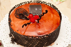 Fruit cake with chocolate and cherries Royalty Free Stock Images