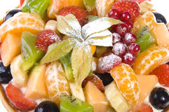 Fruit cake close-up. Cake with many fruits (oranges, strawberries, kiwi, grapes, red currants etc Royalty Free Stock Image