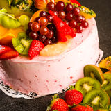 Fruit cake with cream coating and fruits Stock Photo