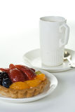 Fruit cake and cup. Coffee cup with fruit cakes on white Royalty Free Stock Images