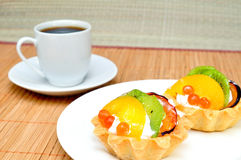 Fruit cake and a cup of coffee Royalty Free Stock Image