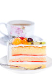 Fruit cake with a cup of coffee Royalty Free Stock Photography
