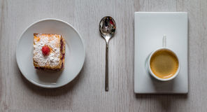 Fruit cake with a cup of espresso coffee Stock Images