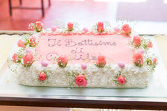 Fruit cake decorated with flowers. Ready for a baptism royalty free stock photo