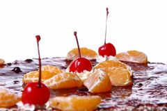 Fruit cake with desert cherry stock images