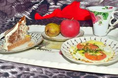 Breakfast on a tray on a bed in closeup at a short distance royalty free stock images