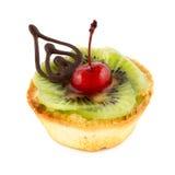 Fruit cake isolated on white. Fresh and tasty fruit cake with kiwi and cherry isolated on white Stock Photo