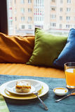 Fruit cake with juice on the table, beside window and pillows. Daylight, selective focus, film effect. Fruit cake with juice on the table, beside window and Royalty Free Stock Images