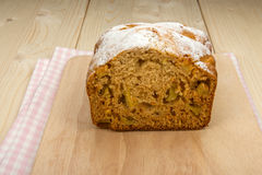 Fruit cake on a linen napkin and a light wooden board Stock Photo