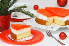 Fruit cake with milk cream and fruit Stock Image