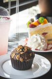 Fruit cake muffin dessert and sweet beverage in cafe.  Royalty Free Stock Photography