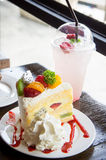 Fruit cake muffin dessert and sweet beverage in cafe Stock Image