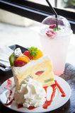 Fruit cake muffin dessert and sweet beverage in cafe Stock Images