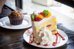 Fruit cake muffin dessert and sweet beverage in cafe.  Stock Image