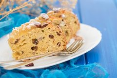 Fruit cake with nuts on white dish stock photography