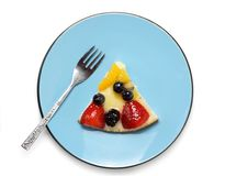 Fruit cake piece. Piece of fresh fruit cake in blue plate, isolated on white Royalty Free Stock Photo