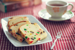 Fruit cake in plate for tea time Royalty Free Stock Images