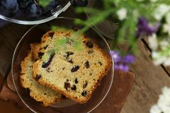 Fruit cake with raisins. On a wooden table royalty free stock image